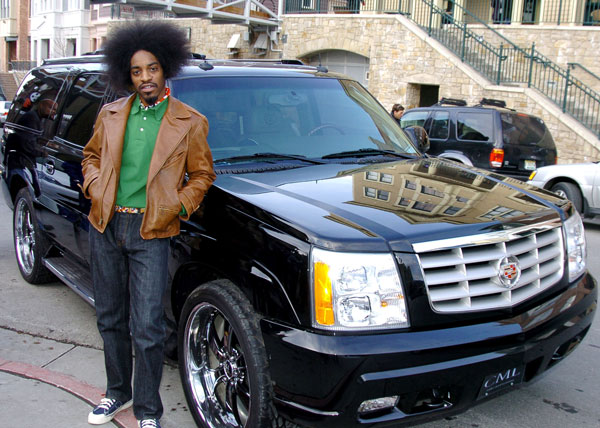 Andre 3000 of OutKast with his Cadillac Escalade