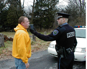 Driving While Intoxicated Being Tested With A Breathalyzer